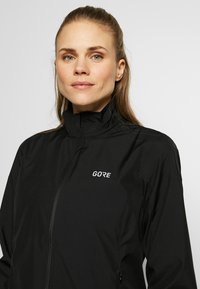 Gore Wear - WINDSTOPPER® CLASSIC JACKE - Windbreaker - black/neon yellow - 3