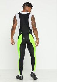 Gore Wear - THERMO TRÄGERHOSE - Legging - black/neon yellow - 2