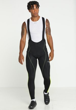 THERMO TRÄGERHOSE - Medias - black/neon yellow
