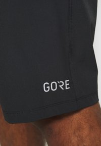 Gore Wear - SHORTS - Sports shorts - black - 6