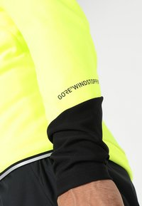 Gore Wear - THERMO  - Soft shell jacket - neon yellow/black - 8