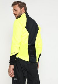 Gore Wear - THERMO  - Soft shell jacket - neon yellow/black - 2