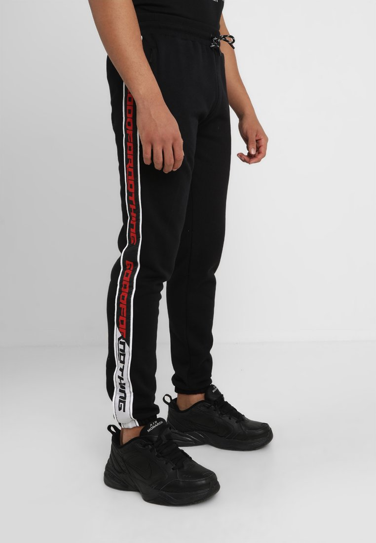 Good For Nothing - JOGGERS WITH LOGO TAPING - Spodnie treningowe - black