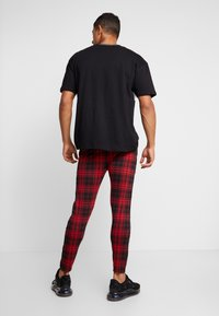 Good For Nothing - FITTED TARTAN TAILORED PANTS WITH BRANDED TAPING - Kangashousut - red - 2