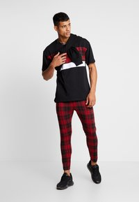 Good For Nothing - FITTED TARTAN TAILORED PANTS WITH BRANDED TAPING - Kangashousut - red - 1