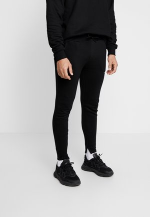 FITTED ESSENTIAL JOGGER - Spodnie treningowe - black