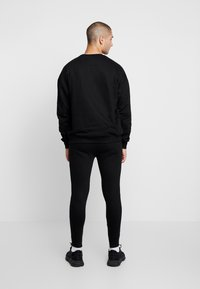 Good For Nothing - FITTED ESSENTIAL JOGGER - Verryttelyhousut - black - 2