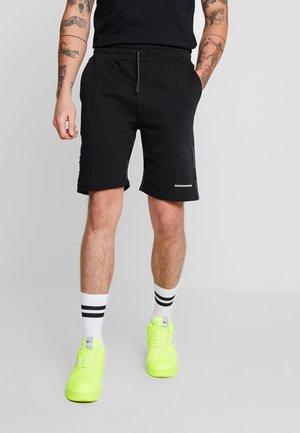FUTURE - Pantalon de survêtement - black