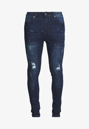SKINNY WITH PAINT SPLATTER - Slim fit jeans - blue