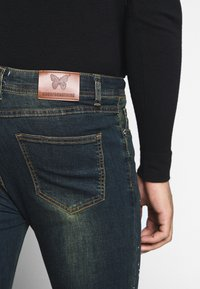 Good For Nothing - WITH PAINT SPLATTER - Jeans Skinny Fit - black - 3