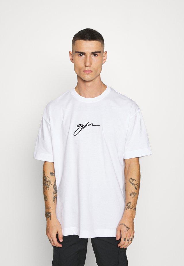 OVERSIZED SCRIPT - T-shirt z nadrukiem - white