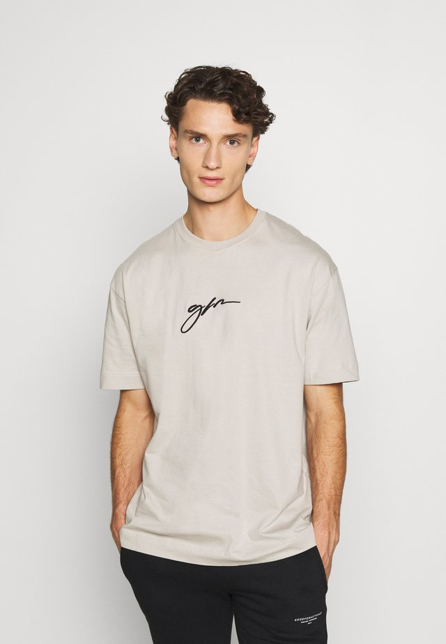 OVERSIZED SCRIPT - T-shirts med print - stone