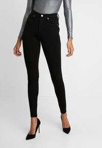Good American - GOOD WAIST PONTE RIDING PANT - Kalhoty - black - 0