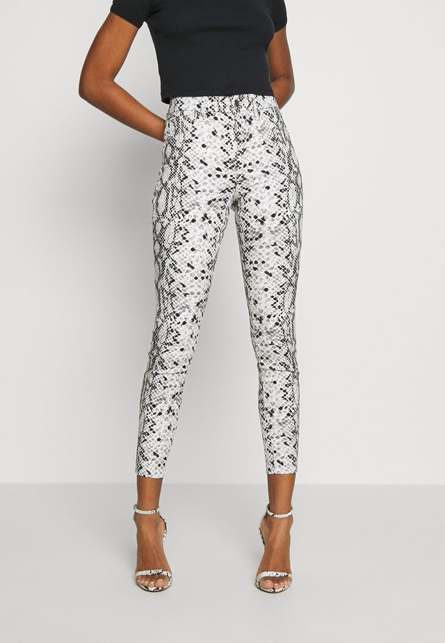 GOOD WAIST SNAKE - Trousers - black/white