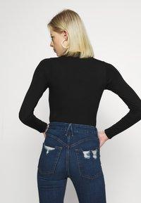 Good American - KEYHOLE - Long sleeved top - black - 2