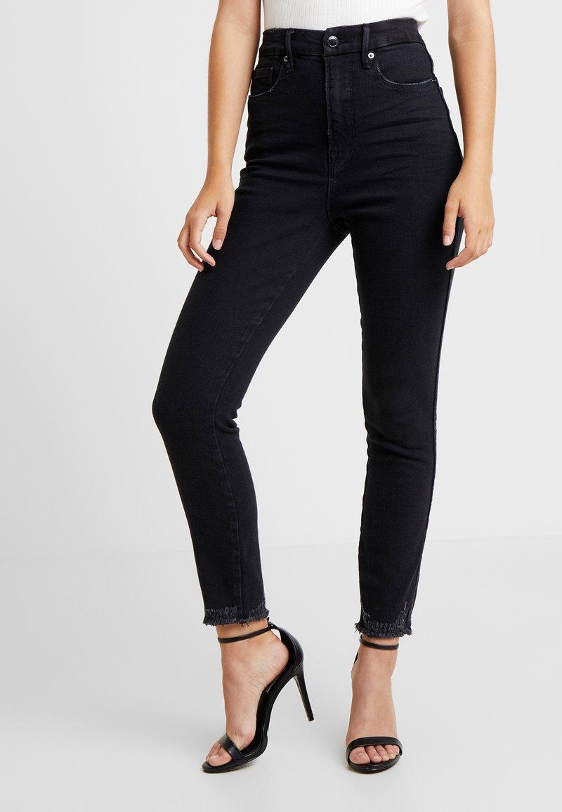 Good American - CURVE CROP CHEWED - Jeans Skinny Fit - black