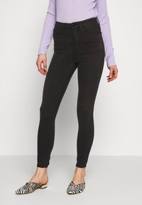 Good American - GOOD WAIST EXTREME AT BACK - Jeans Skinny Fit - black - 0