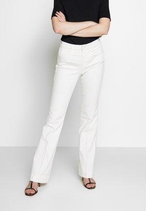 GOOD - Flared Jeans - white