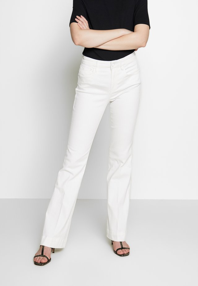 GOOD - Flared jeans - white