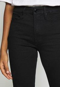 Good American - Straight leg jeans - black - 4