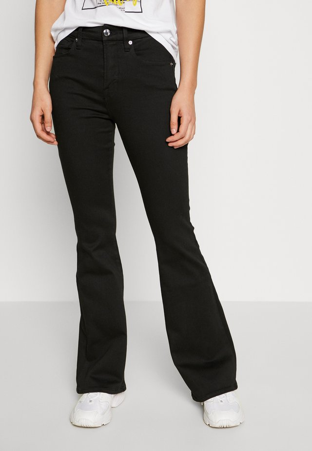 THE FLARE - Flared jeans - black