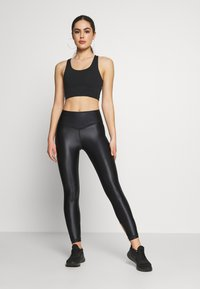Good American - LIQUID CROSSOVER LEGGING - Tights - black - 1