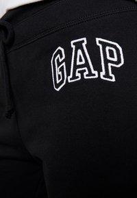GAP - Tracksuit bottoms - true black - 5