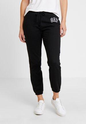 Pantalones deportivos - true black