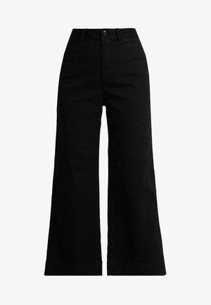 WIDE LEG SOLID - Flared Jeans - true black
