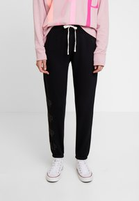 GAP - Pantalones deportivos - true black - 0