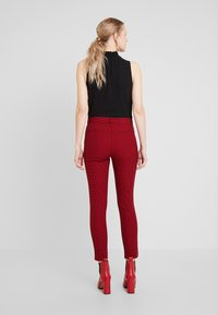 GAP - ANKLE BISTRETCH - Trousers - black/red - 3