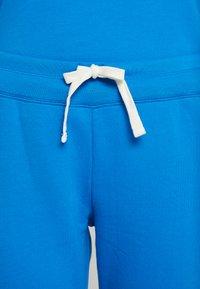 GAP - Spodnie treningowe - precious blue - 3