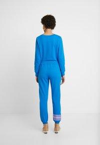 GAP - Spodnie treningowe - precious blue - 2