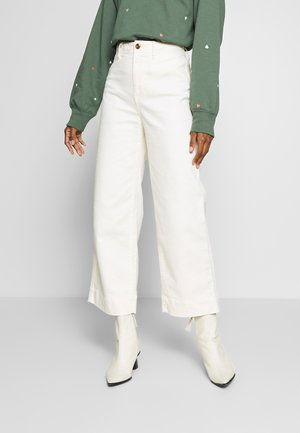 WIDE LEG CHINO SOLID - Flared jeans - ivory frost
