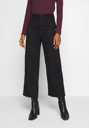 WIDE LEG CHINO SOLID - Flared jeans - true black
