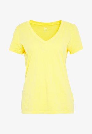 T-shirts med print - new marigold