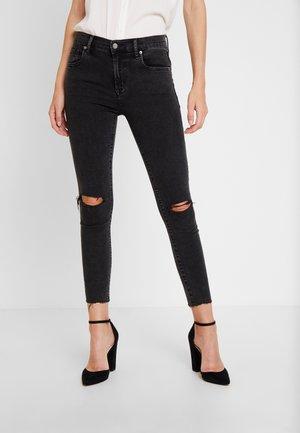 WASHED SLASH - Jeans Skinny Fit - washed black