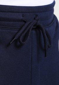 GAP - MODERN LOGO - Tracksuit bottoms - tapestry navy - 4