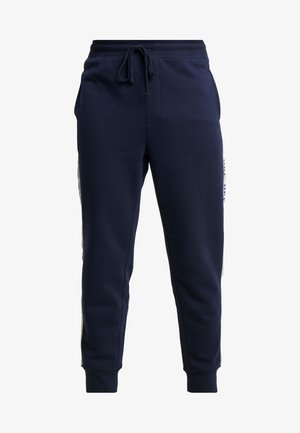 LOGO TAPE JOGGER - Tracksuit bottoms - tapestry navy