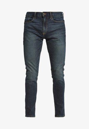 TAPER AUTHENTIC  - Zúžené džíny - dark indigo
