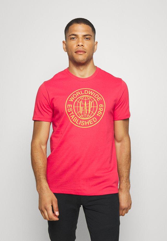 WORLD CIRCLE - Print T-shirt - hawaiian red