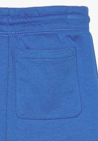 GAP - TODDLER BOY LOGO - Teplákové kalhoty - blue burst - 4