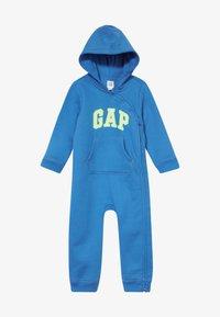 GAP - LOGO  - Overal - blue burst - 2