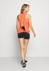 GAP - TIE BACK TANK NON HOT - Sports shirt - fiery coral neon - 2