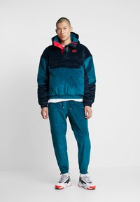 Grimey - ENGINEERING TRACK PANTS - Tracksuit bottoms - green - 1