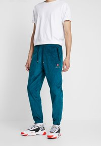 Grimey - ENGINEERING TRACK PANTS - Tracksuit bottoms - green - 0