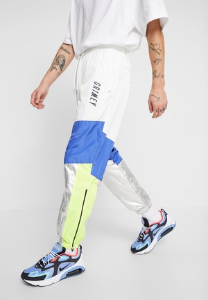 PLANETE NOIRE TRACK PANTS - Tracksuit bottoms - white
