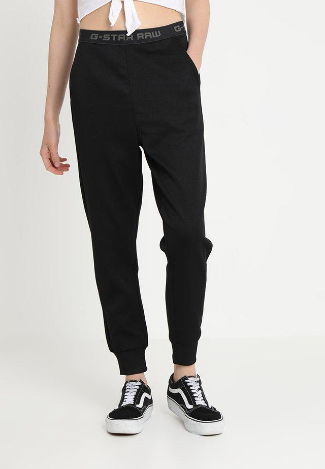 RIE CROPPED SLIM SW PANT WMN - Pantalones - black