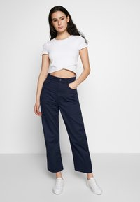 G-Star - TEDIE ULTRA HIGH STRAIGHT RIPPED ANKLE - Trousers - sartho blue - 1