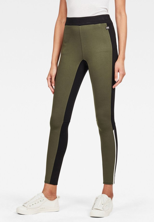 NOSTELLE HIGH LEGGING - Legging - dark black/algae